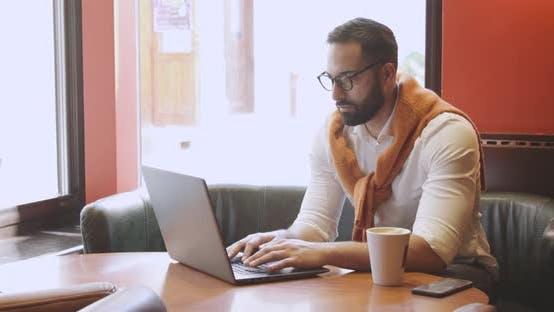 Adult Entrepreneur in Cafe