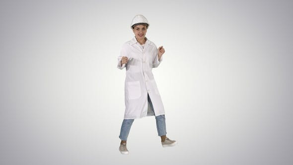 Thumbnail for Engineer woman dancing in funny way on gradient background