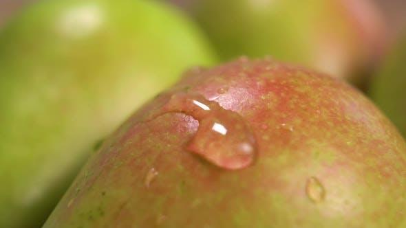 Droplets splashing on a ripe pear in slow motion