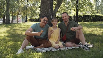 Gay Couple With Daughter In Park
