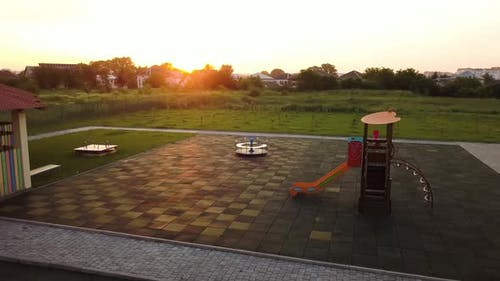 Footage on preeschool yard with swings and slides.