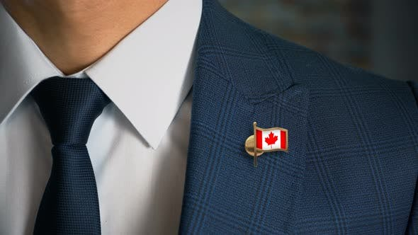 Thumbnail for Businessman Walking Towards Camera With Country Flag Pin Canada