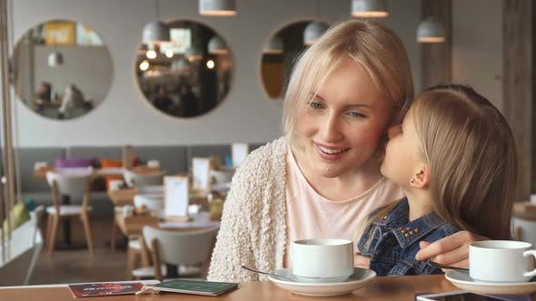 Thumbnail for Little Girl Shares Some Secrets with Her Mother