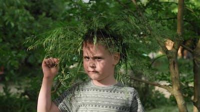 Funny cute little boy in wreath