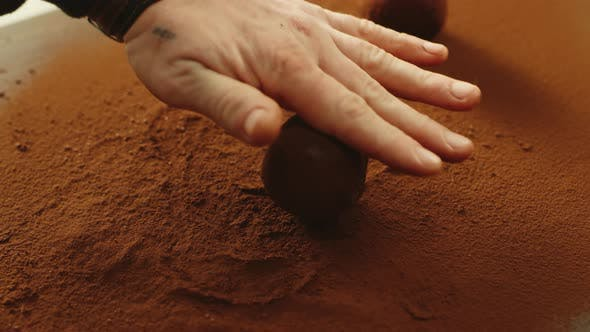 Thumbnail for Chef Rolling Truffle Ball in Cocoa Powder in Slow Motion.