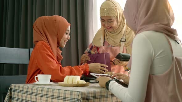 Thumbnail for Asian Muslim Woman Using Mobile Phone Payment