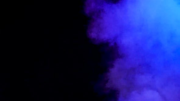Thumbnail for Colorful Abstract Blurred Smoke Rising Over a Black Background