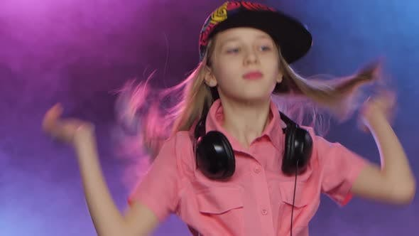 Thumbnail for Stylish Teenager Girl Plays Music at Dj Table, Smoky Background