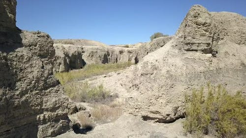 Slowly flying through dry eroded riverbed