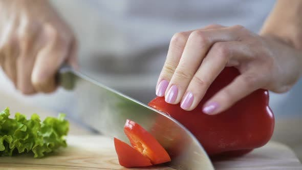 Woman's Hands Slicing Bulgarian Pepper, Lady Cooking Delicious Dinner for Family