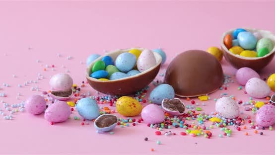 Thumbnail for Happy Easter overhead with Easter eggs and decorations on a Pink Background. Dolly shot