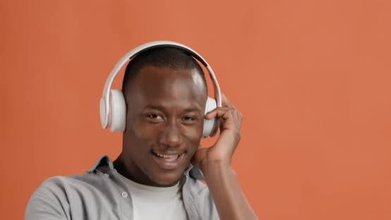 Thumbnail for Positive African American Guy in Headset Dancing, Enjoying Music