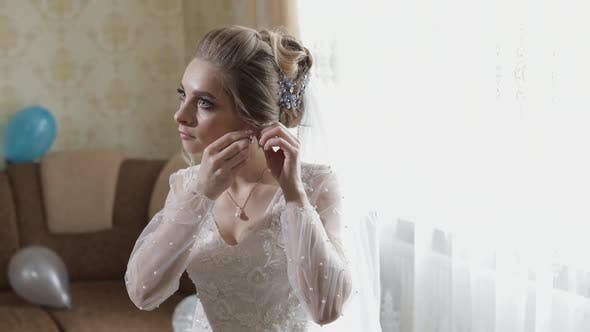 Thumbnail for Elegant Blonde Bride Wear Beautiful Earrings. Woman at Wedding Morning