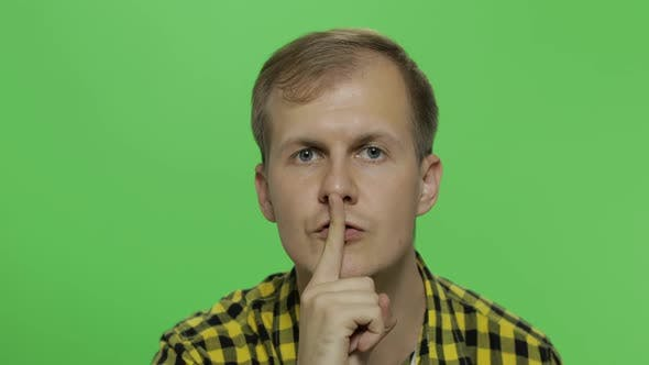Thumbnail for Man Keeping a Secret or Asking for Silence, Serious Face, Obedience Concept