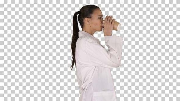 Female doctor drinking coffee and walking, Alpha Channel