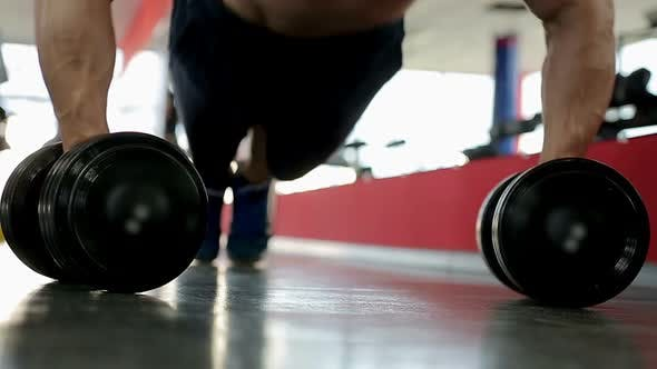 Cover Image for Professional Bodybuilder Doing Dumbbell Push-Ups, Training Hard During Workout