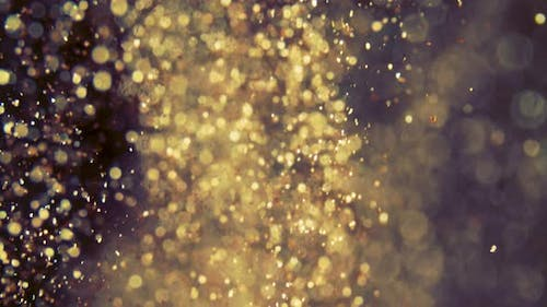 Abstract Golden Particles with Blurred Defocused Bokeh Moves Chaos, Snow Flakes