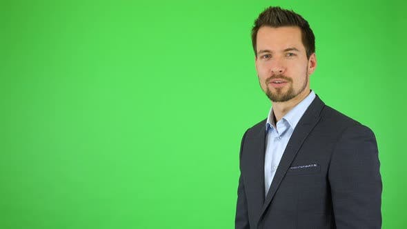 Thumbnail for A Young Businessman Talks To the Camera and Double Clicks at a Particular Spot - Green Screen