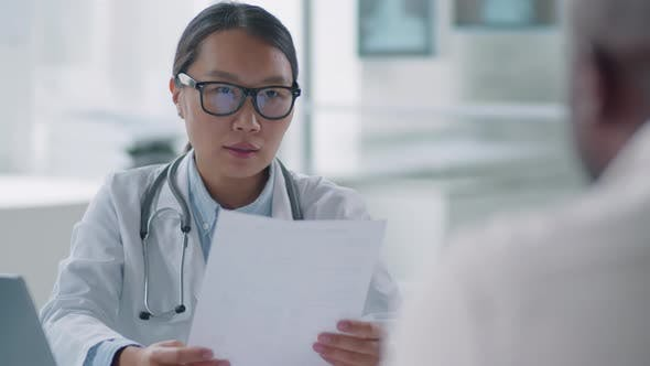 General Practitioner Working With Patient