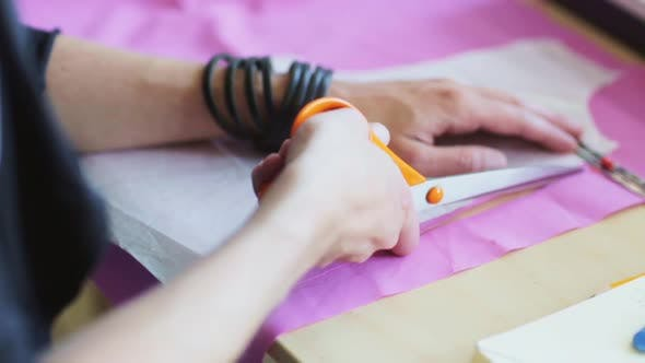 Thumbnail for Fashion Designer Hands Cutting Cloth with Scissors 18