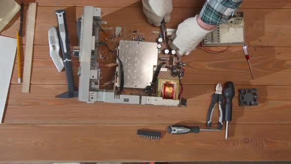 Engineer Using Pliers Breaks Off Computer Parts