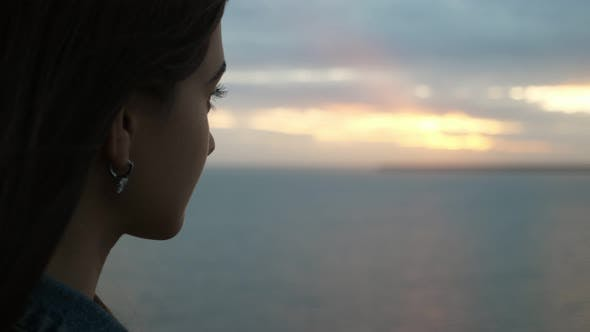 Thumbnail for Beautiful Girl with Long Eyelashes Enjoying the Black Sea Waves in Slo-mo