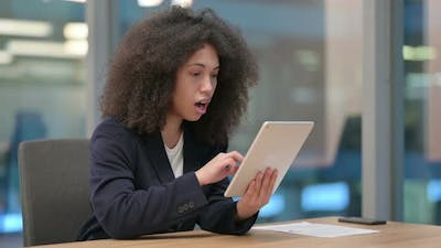African Businesswoman Reacting to Loss on Tablet