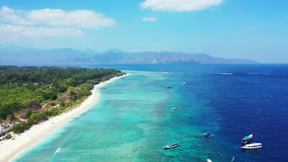 Thumbnail for Tropical birds eye clean view of a white sand paradise beach and blue water background in colorful