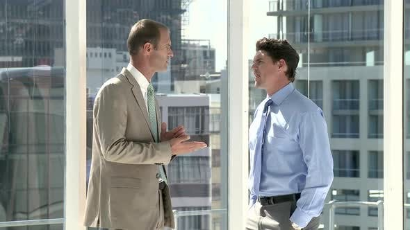 Thumbnail for Two businessmen talking in office