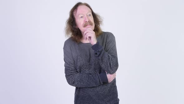 Thumbnail for Senior Man with Mustache Thinking Against White Background