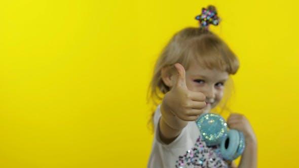 Thumbnail for Child Dances, Listens Music, Little Kid Girl with Headphones Dancing, Having Hun, Relaxing, Enjoying