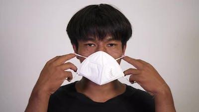 Asian man wearing medical mask