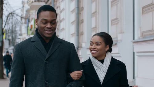 Happy African American Couple Walking Around City Holding Hands and Talking Slow Motion