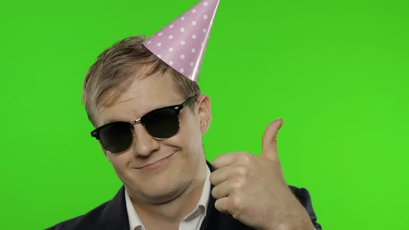 Thumbnail for Drunk Sleepy Businessman in Festive Cap Wear Sunglasses Giving Thumbs Up