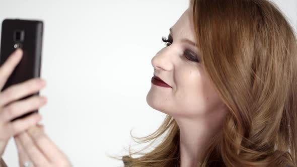 Thumbnail for Attractive red head flipping hair and making kiss face for selfie