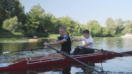 Cover Image for Young Sports Team Two Teenage Boys with Double Boat Kayak