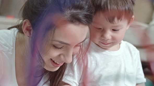 Thumbnail for Tender Moment Between Mother and Son