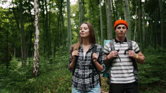 Amazed Tourists in Forest