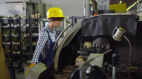 Thumbnail for Female cutting lathe operator at work