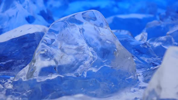 Thumbnail for Pieces of Ice Lies on the Table, Blue Illumination Beautifully Lies Over Fragments