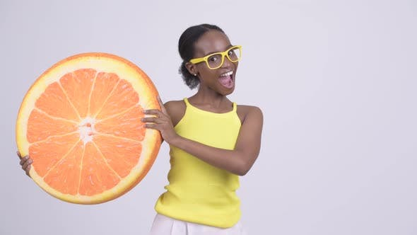 Cover Image for Young Happy African Woman Holding Orange Pillow As Healthy Concept