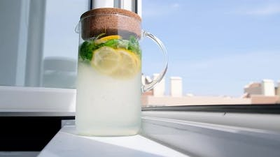 Homemade Lemonade in Glass Jug on Window