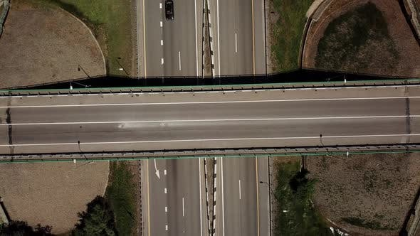 Thumbnail for Top Down Zoom Out View of Highway Intersection Car Bridge and Moving Cars