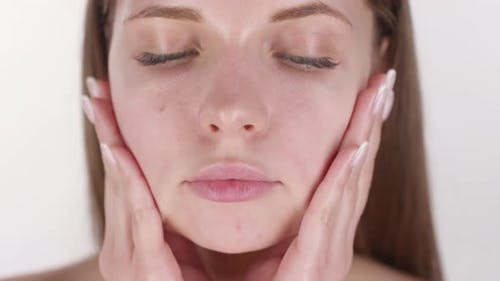 Pretty Woman Rubbing Face