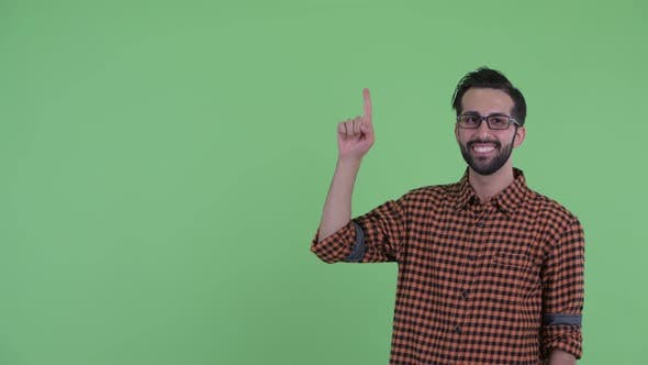 Thumbnail for Happy Young Bearded Persian Hipster Man Talking and Pointing Up