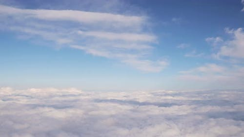 Beautiful Aerial View Of Clear Sky Over White Fluffy Clouds From Height Flight Of Plane