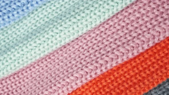 Multiple Loops of Yarn on Colorful Fabrics  Slow Pan Footage. Abstract Background