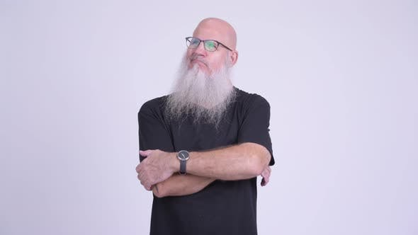Thumbnail for Mature Bald Bearded Man Looking Bored and Frustrated