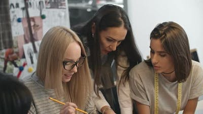 Designers Working Together in Fashion Studio