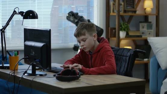 Thumbnail for Wheelchaired Boy Using Computer